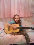 Daisy playing guitar