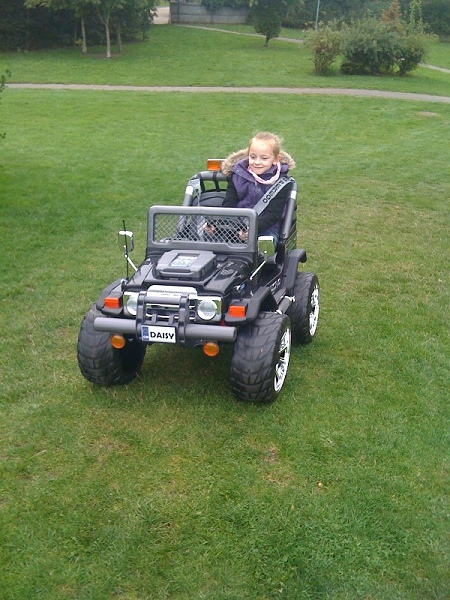 Daisy in her electric 4x4 car